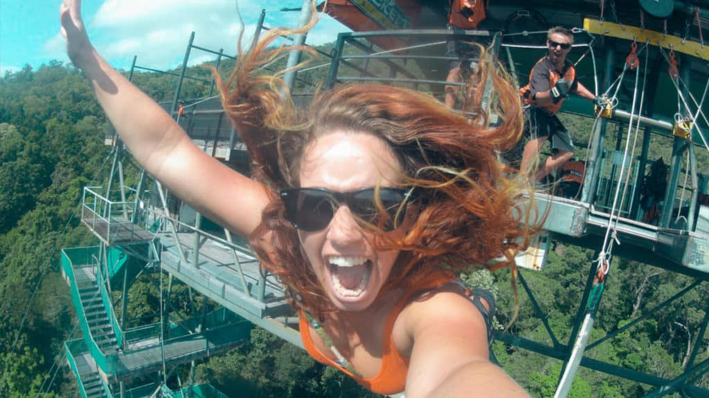 A girl goes bungy jumping