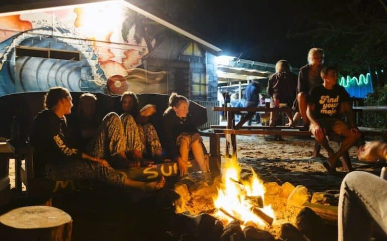 backpackers gathered around a campfire