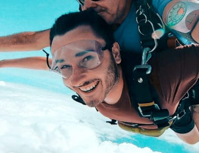 Traveller skydives with instructor