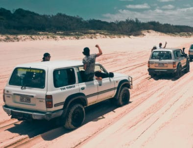 Four-wheel drive cars driving on the sand on Fraser Island