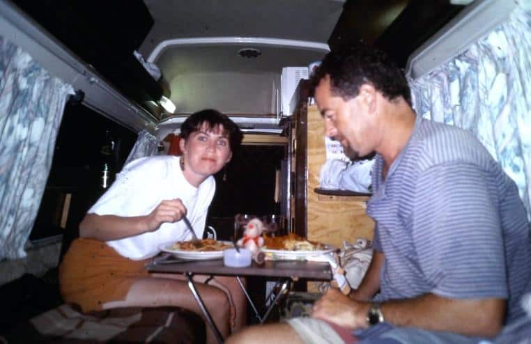 Ruairi's parents eating inside their campervan